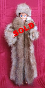 Full length fur doll coat with natural pastel mink sides and lunaraine mink tuxedo front.