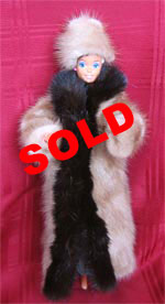 Full length fur doll coat with natural pastel mink sides and full skin ranch mink tuxedo front.