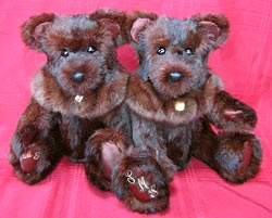 A set of fur teddy bears made from a stenciled rabbit cape.
