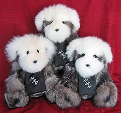 A trio of custom fox fur teddy bears wearing monogrammed scarves.