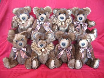 Muskrat fur teddy bears with raccoon collars