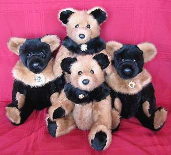 Four two-tone teddy bears made from two mink fur coats