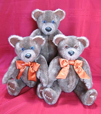 A trio of faux fur teddy bears