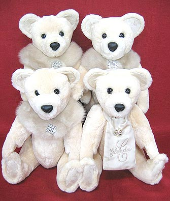 Four mink teddy bears with collars, scarf and monogrammed