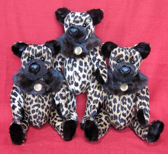 Three faux cheetah teddy bears with real mink fur accents