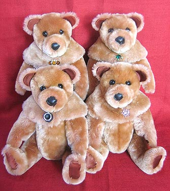 Four Golden Mouton Lamb teddy bears with matching collars