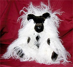 White Tibetan lamb teddy bear with sheared mink snout, fore head, ears, paw pads, and chest.