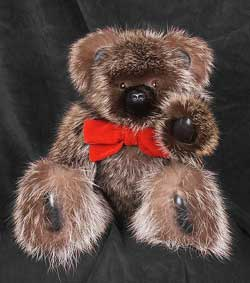 Natural raccoon fur teddy bear with sheared mink snout.