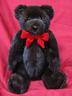 Full Skin Natural Dark Ranch mink fur teddy bear with matching leather paw pads and ears.