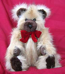 Polar raccoon teddy bear with sheared beaver snout, paw pads and ears.