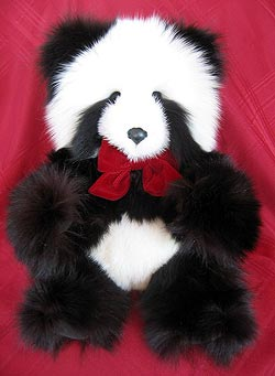 Black and White fox teddy bear with white mink snout, black suede paw pads.